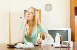 pensive woman counting the cost of medications for treatment at home