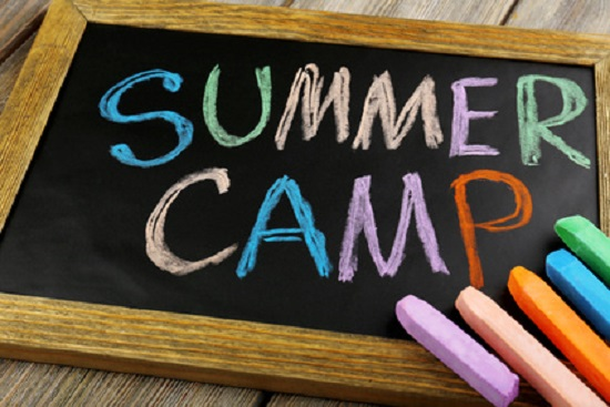 Summer Camp written on chalk board