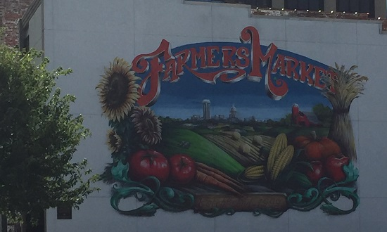 building mural with vegetables and words farmers market