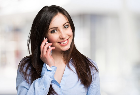 Young smiling woman talking on the mobile phone