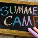 Summer Camp written on chalk board