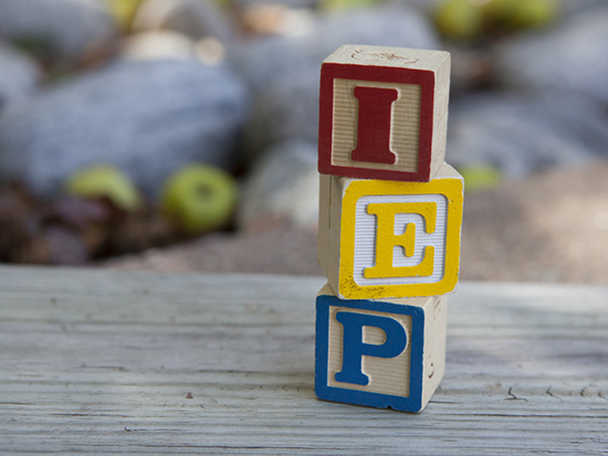Child blocks spelling out IEP