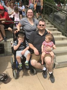 DSCC Family Advisory Council member Cassie Gluck poses with her two sons and husband.