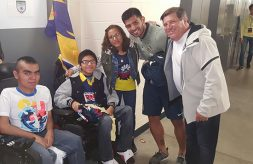 Brothers with muscular dystrophy pose with members of the Club America soccer team and their mother.