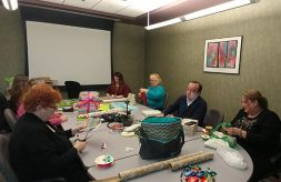 DSCC's Springfield Regional Office wraps presents for a DSCC toddler in need.