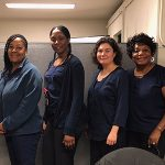 Five Chicago Public Health Department nurses and a hearing screening trainer pose together.