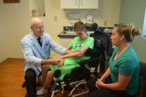Dr. Keith Gabriel examines patient Aidan Stricklin.