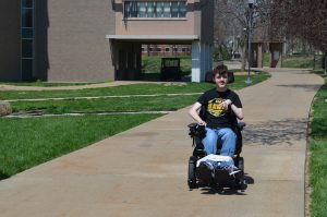 Jacob Flynn poses on Quincy University's campus