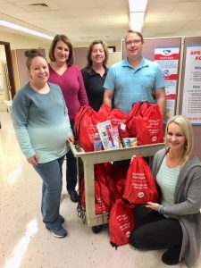 DSCC's Marion and Olney RO staff pose with backpacks filled with items for family caregivers