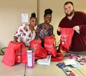 DSCC's Champaign Regional Office staff fill red backpacks with items for family caregivers.