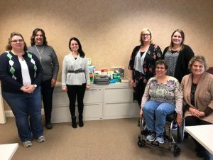 DSCC's Peoria RO staff pose with items they donated to Almost Home Kids.