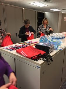 DSCC's Rockford RO staff fill backpacks with items for family caregivers.