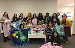 DSCC's Lombard RO staff poses with blankets they made for caregivers