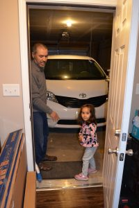 Jaouad Barmaki points out the zero-step entrance from the garage into his family's new home.