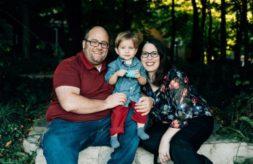 DSCC participant Jakob Kojro-Badziak smiling and posing with his parents, Jason and Jennifer