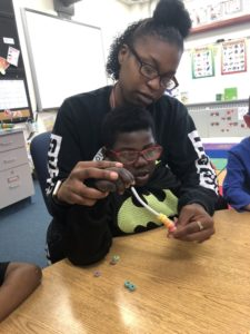Stanton Whitted works on a project with his aide at Illinois School for the Deaf.