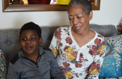 Nedra Whitted smiles at her grandson Stanton as the two sit together
