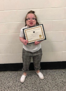 Makenzie Hardesty poses with the award she received during Senior Awards Night.