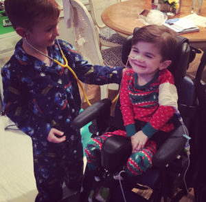 Nash's older brother, Blake, pretends to check Nash with a stethoscope.