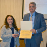 2019 DSCC Award of Merit Winner Yesenia Bustamante shakes hands with Executive Director Thomas Jerkovitz