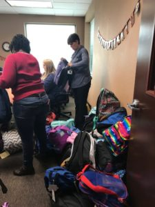 DSCC staff sort donated backpacks for our participants.
