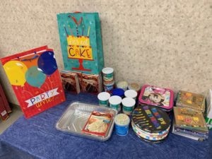 Cake mix, frosting, plates and other items that DSCC's Champaign Regional Office collected for their birthday bag project.