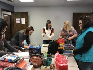 """DSCC's Olney staff have a """"wrapping party"""" for families in need."""