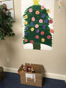 Peoria's giving tree and donation box.