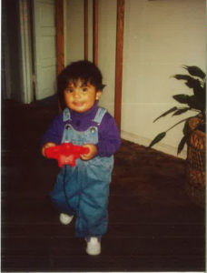 Former DSCC participant and current employee Lisette Rios smiles as a toddler.