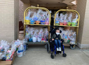Axel poses with the 160 Easter baskets his family donated for pediatric patients at Central DuPage Hospital.