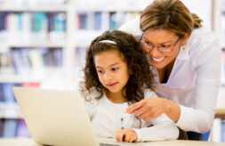 Mother and daughter looking at a laptop computer