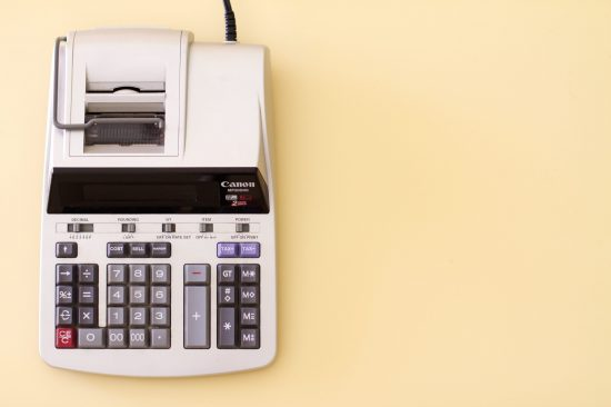 printing calculator on a yellow background