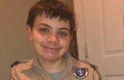 Nathan Lichucki smiles while wearing his Boy Scouts uniform