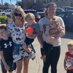Lace Mandrell and Bailey Imig pose and smile with their children
